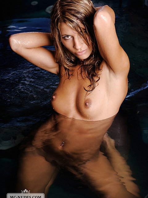 hot girl posing in swimming pool